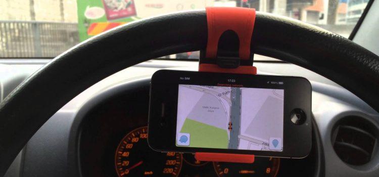 Steering wheel phone holder